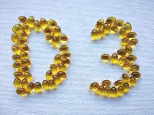 Rumene kapsule v obliki črke d in številke 3.